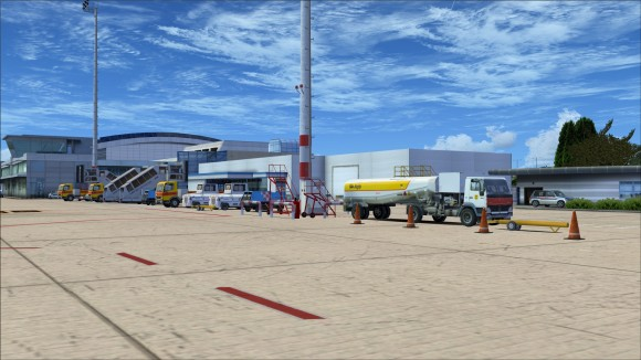 Assortment of vehicles and objects along apron lines