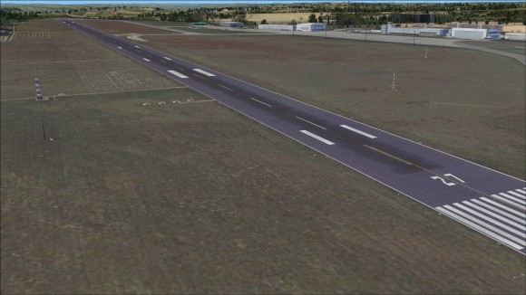 Runway 09L27R located between the red and white poles to the right of runway 09 27