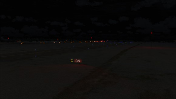 Taxiway sign light reflecting on ground