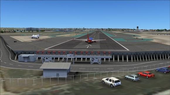 Nice view of aircraft lining up for take off on runway 27 with the localizer and blast fencing in view