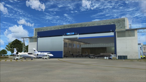 Business jets inside and outside of hangar