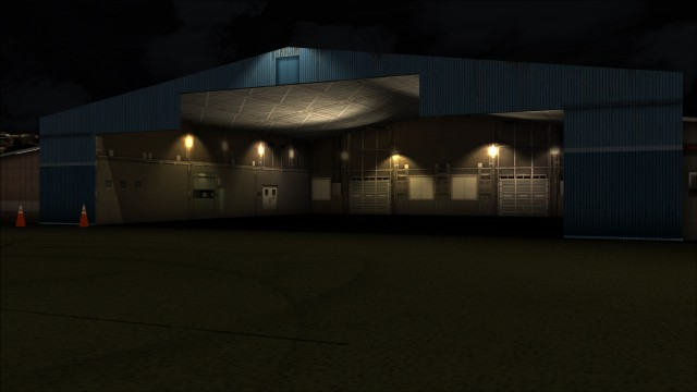 GA hangar lit up at night