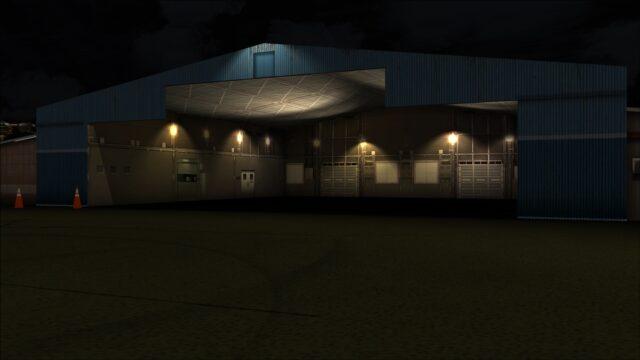 GA hangar lit up at night