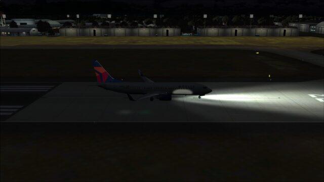 Taxiing past hangars