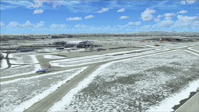 Snow drifted on edges of taxiway
