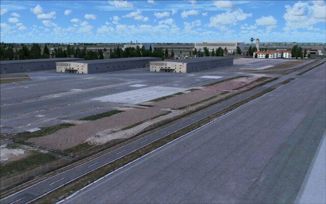 Buildings near end of runway 07R