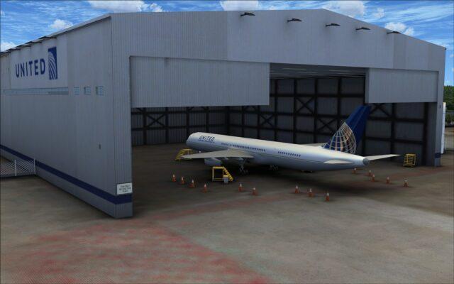 Open hangar with aircraft