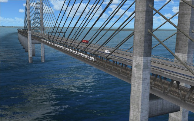 Close up of center span of Øresund Bridge with rail and vehicle traffic