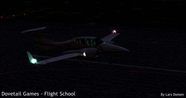 The exterior of the DA-42 with all lights on.